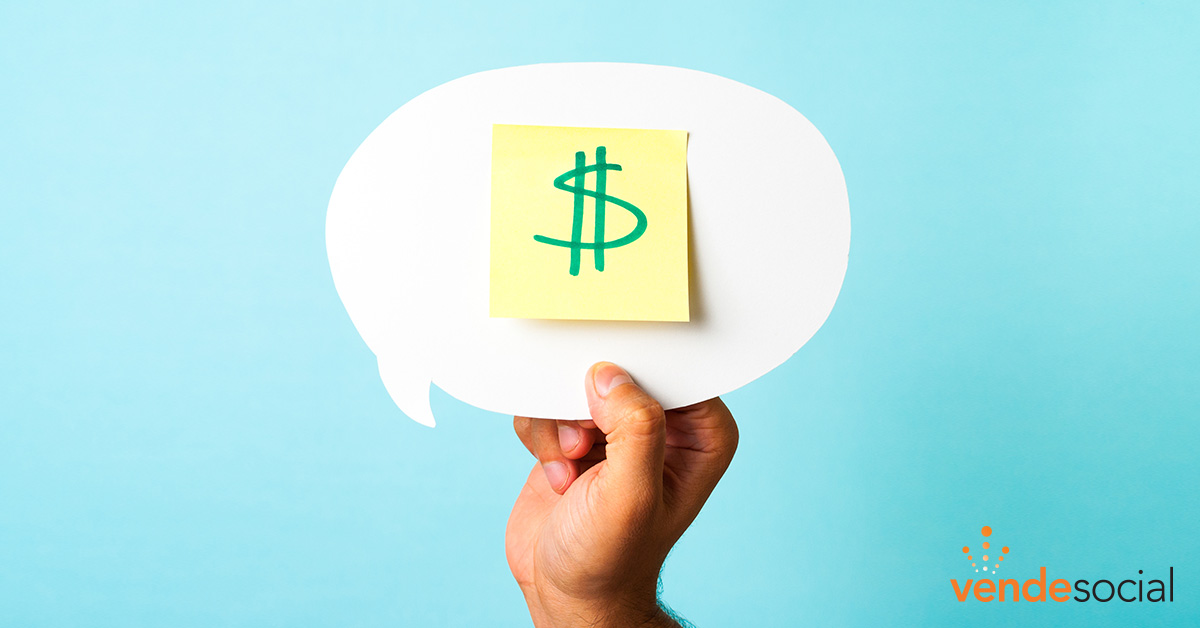 Person holding a speech bubble cutout with a sticky note on it. On the sticky note is a written dollar sign. | Digital Advertising Agency
